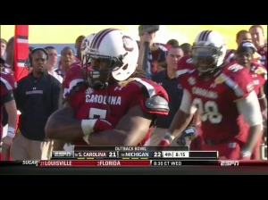 JaDaveon Clowney flexing post-kill.